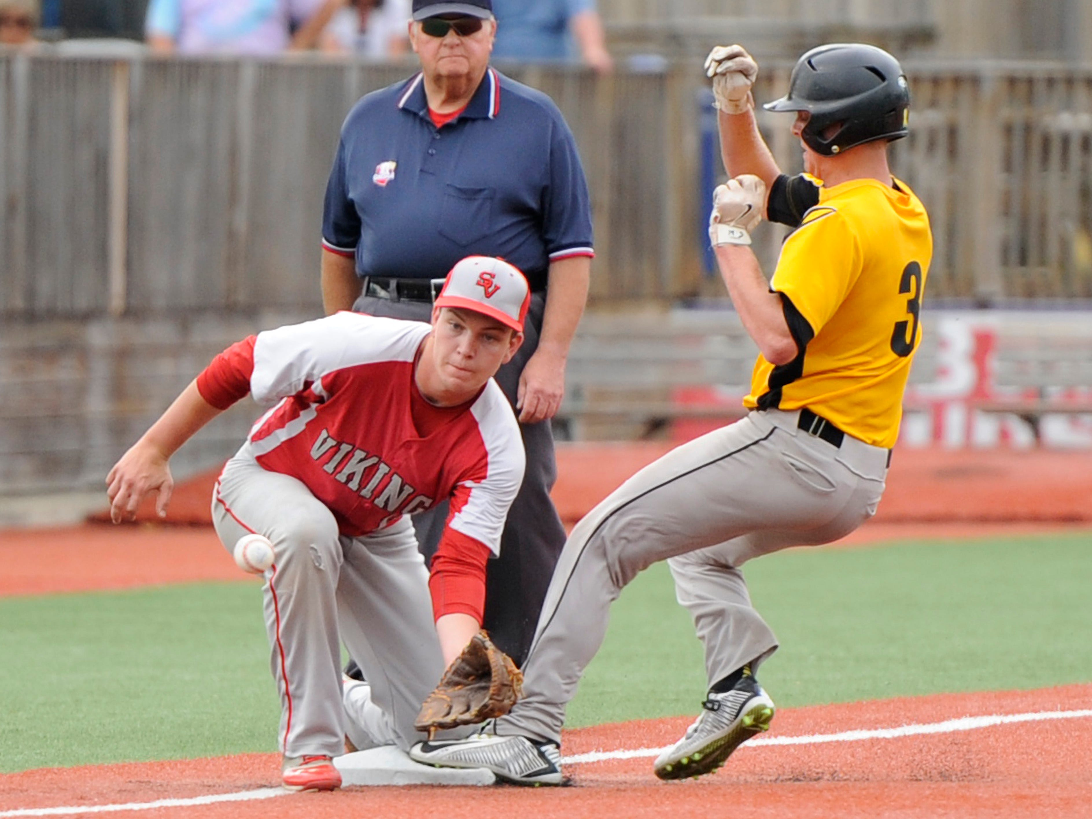 Paint Valley's Anthony McFadden manages to safely slide into third base during the Division IV District Final against Symmes Valley at V.A. Memorial Stadium, Monday night. The final score was Paint Valley 5, Symmes Valley 4.