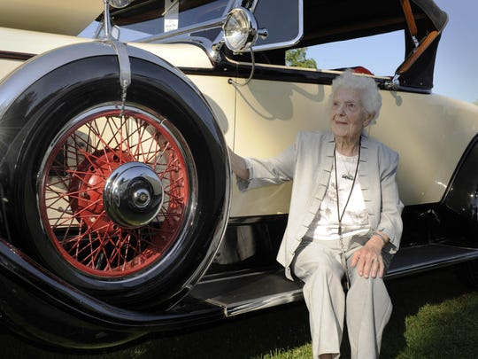 Margaret Dunning, at 101, sits on the running board of her 1930 Packard 740, which she drove for three laps at Indianapolis Motor Speedway in 2013.