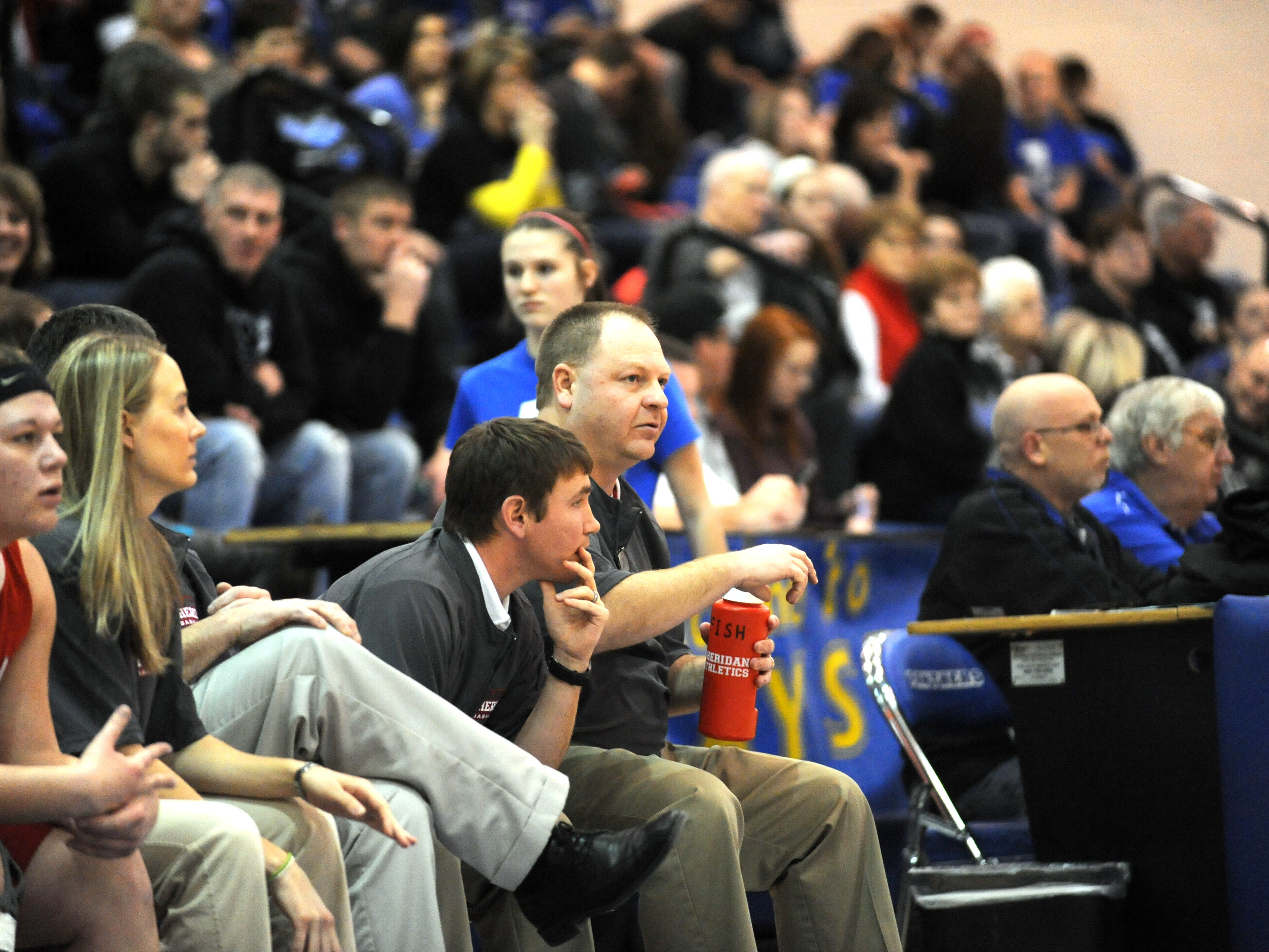 Sheridan coach Doug Fisher and J.D. Walters assess play during a girls basketball game against Maysville last season. Fisher will be now be the head boys coach, while Walters was promoted to head girls coach, the school announced.