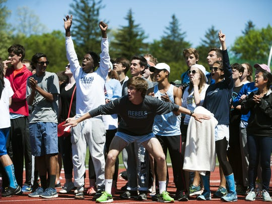 South Burlington celebrates the team championship during the Division I high school track and field state championship meet at Burlington High School on Saturday.