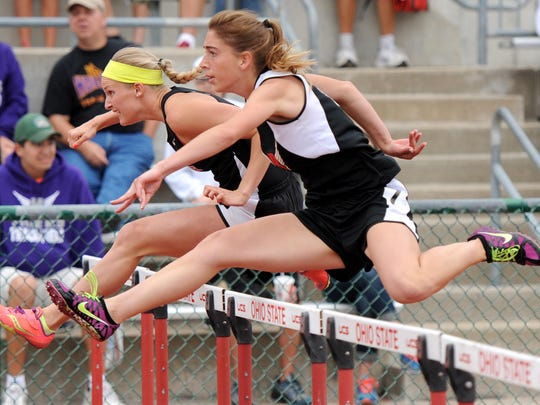 Samantha Swackhammer of Rosecrans Bishops competes in the 100 meter hurdle race during the state track meet at Jesse Owens Memorial Field on Saturday in Columbus.