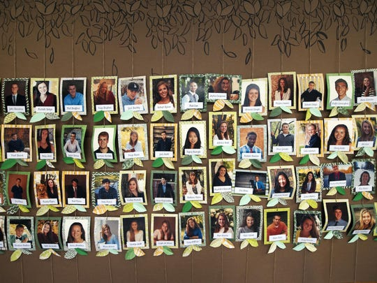 Senior photos hang on the wall in the lobby during the Rice Memorial High School graduation ceremony at Rice on Sunday June 7, 2015 in South Burlington. (BRIAN JENKINS/for the FREE PRESS)