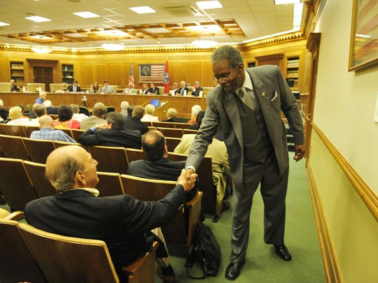 Senator Reginald Tate says hello to former Speaker Jimmy Naifeh during a hearing to legalize physician-assisted death in Tennessee in Legislative Plaza in downtown Nashville, Tenn. June 9, 2015.