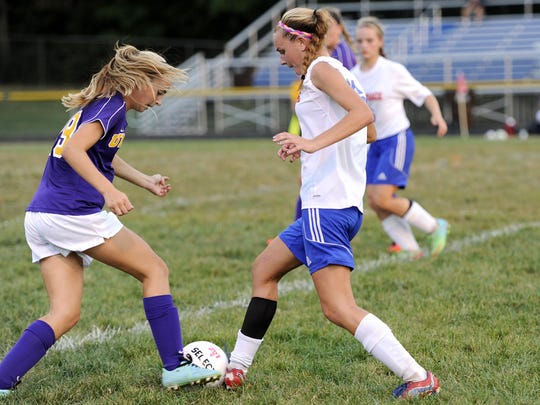 Unioto's Montana Myers, left, tries to steal the ball from her sister, Zane Trace's Mady Myers, during a 2014 regular season game. Montana will be wearing No. 16 in 2015, honoring Mady, who was injured in a car wreck this past May.