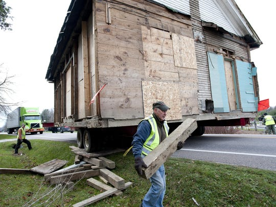 A Roger Brothers crew works to safely move the Little Red Schoolhouse across Route 2A in St. George on Nov. 7, 2012. The schoolhouse was built in 1852 and held its last class in 1965.