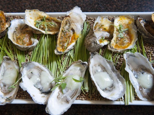 Grilled oysters, such as these prepared at Rastelli Fresh Market in Voorhees, are a great choice at a shore house.