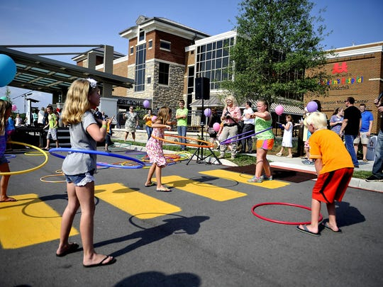 Children compete in a hula hoop contest at a sneak peek event for the Monroe Carell Jr. Children's Hospital Vanderbilt at Williamson Medical Center, which opens July 1 in Franklin.