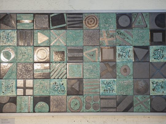 'Signs and Symbols II' is a work in tile by Zola Bryen of Cherry Hill, on display at Perkins Center for the Arts in Collingswood as part of the 'Assemblage' exhibition.