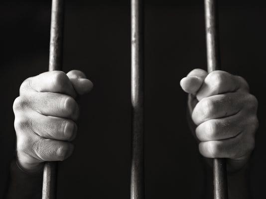 hand behind bars prison jail