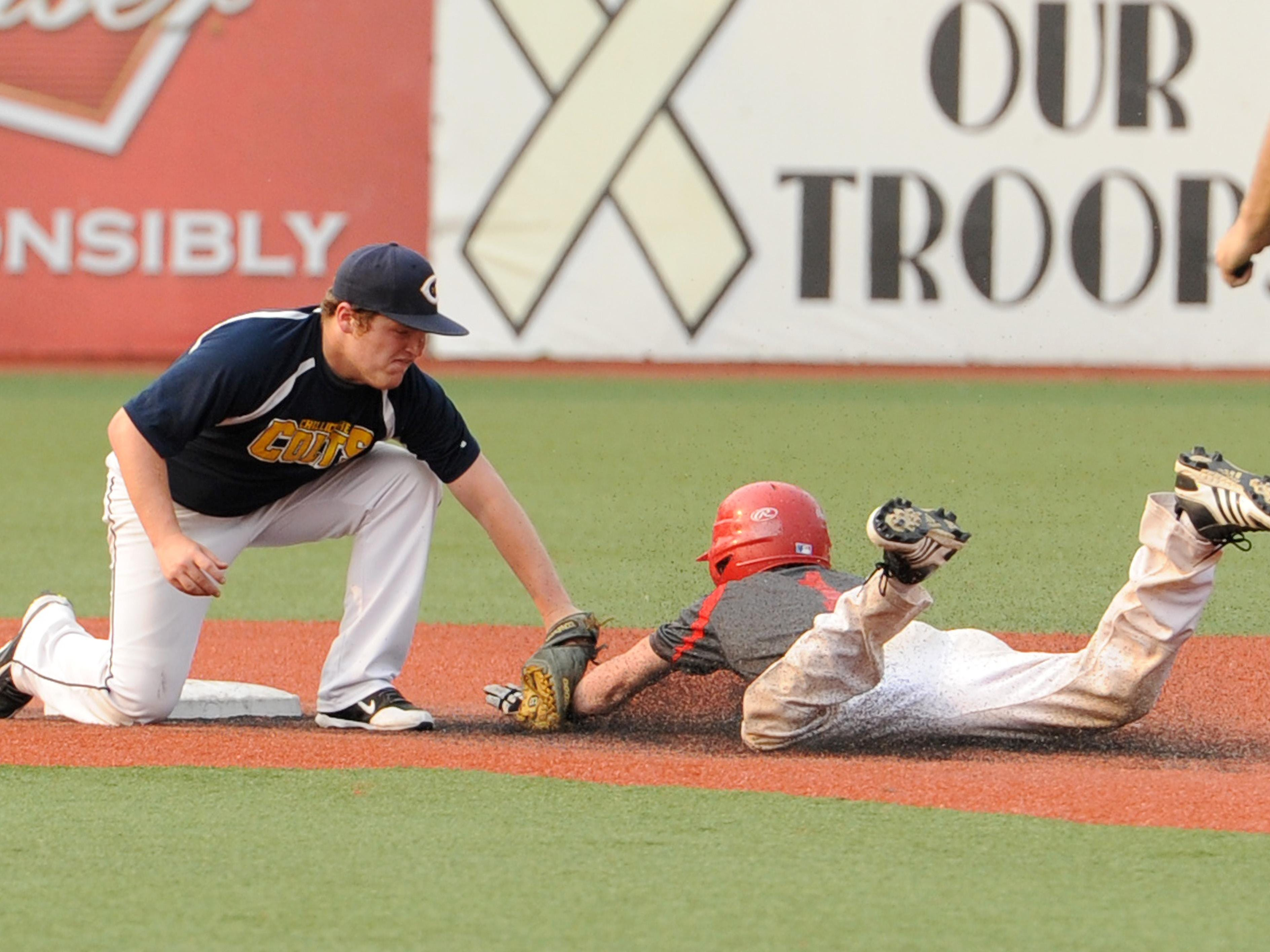Chillicothe Post 757's Zack Stapleton tags out Washington Courthouse Post 25 at second base during the game at V.A. Memorial Stadium on Wednesday.