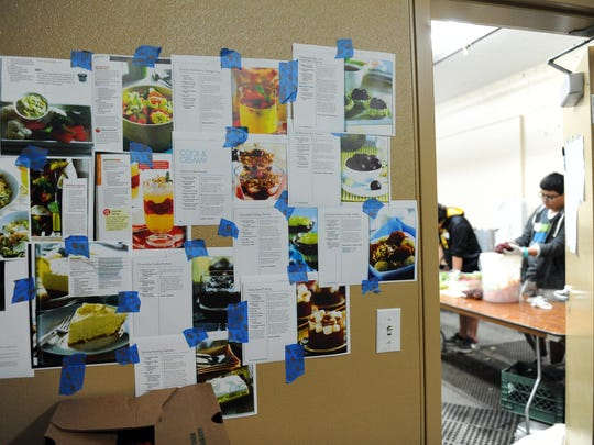 Recipes cover the wall opposite the walk-in freezer in the small kitchens underneath the grandstands at the 2015 California Rodeo Salinas.