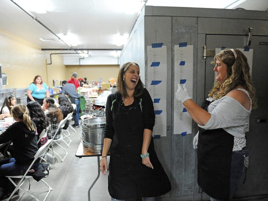 Kitchen manager Jennifer Rosbach, right, has a laugh during Wednesday's food preparations for the sponsor hospitality tent at the 2015 California Rodeo Salinas. Seventeen of Rosbach's family members are volunteers in the effort.