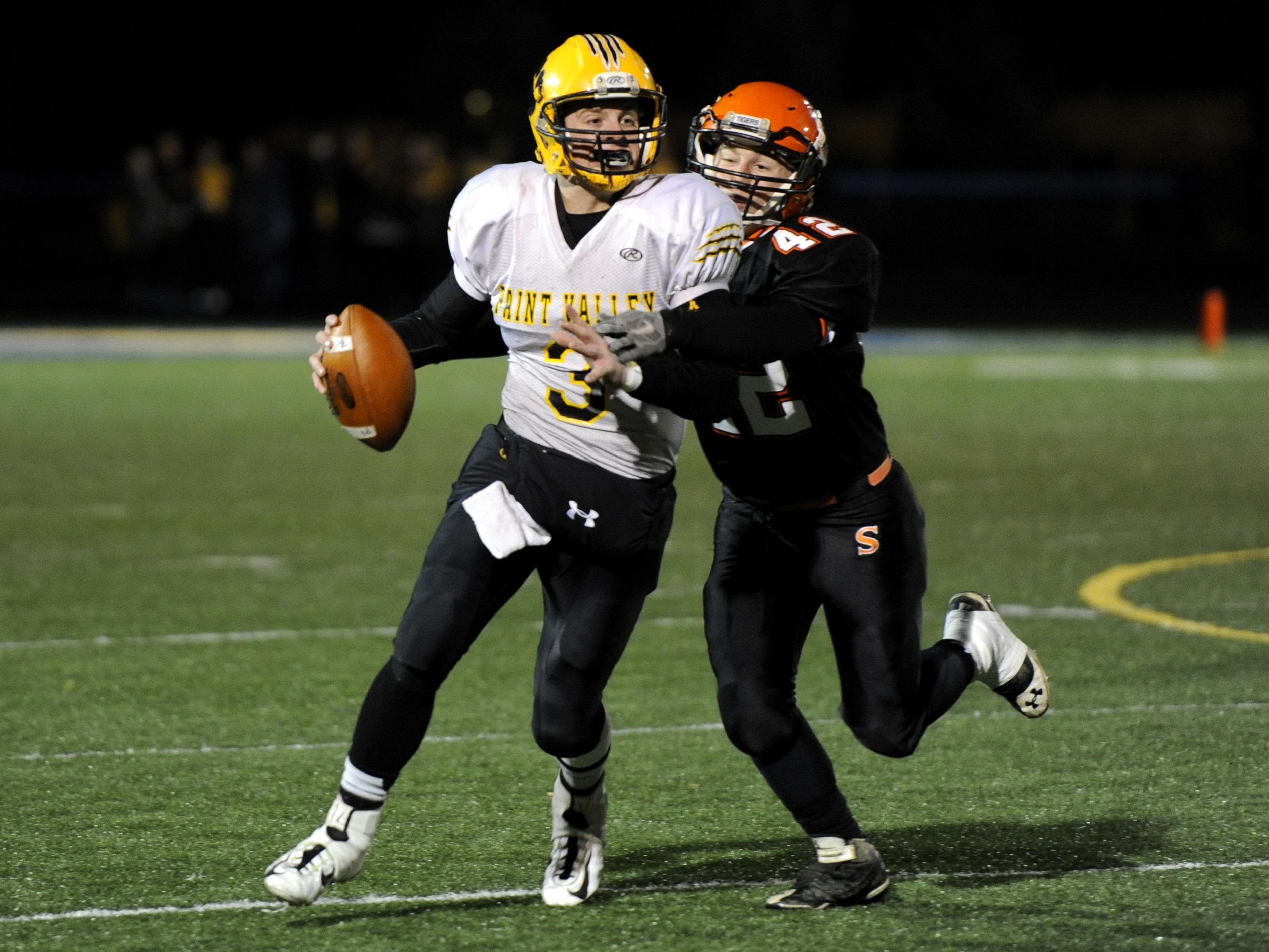 Paint Valley's Anthony McFadden attempts to elude a defender during last year's Division VII regional semifinal against Shadyside at Maysville High School. McFadden, now a senior, will attempt to lead his Bearcats to a third straight playoff appearance in 2015.