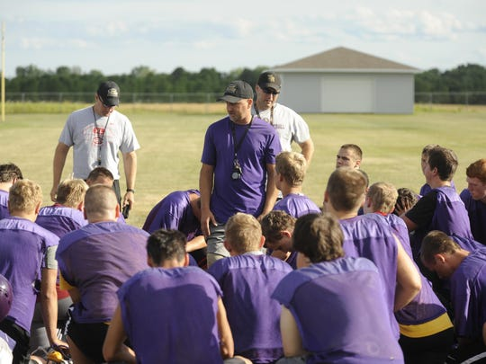 Two Rivers head coach Kevin Shillcox talks to his team