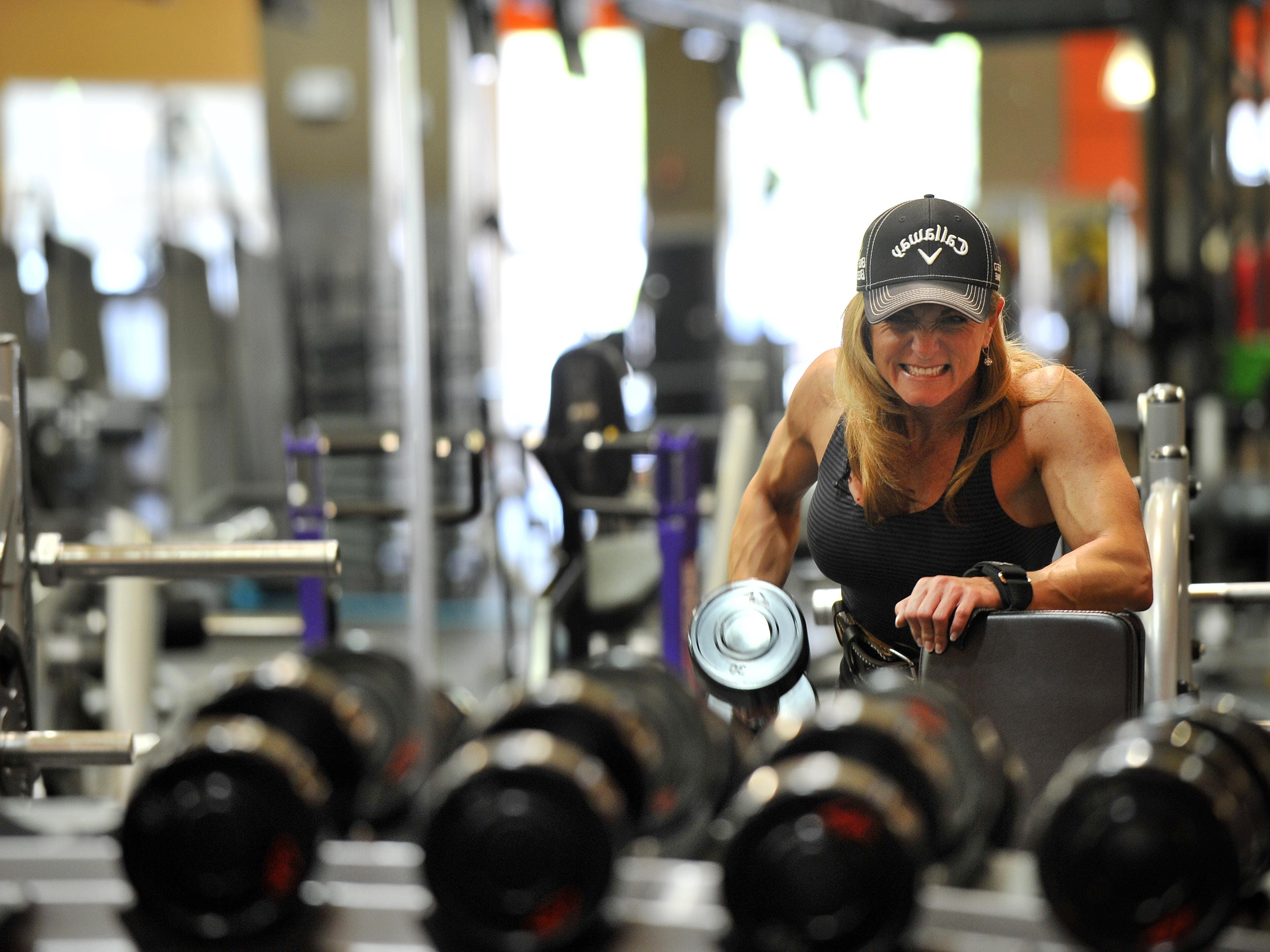 Marie Ann 'Mo' Newman works out her shoulders and back at Golds Gym in Greenville on Friday, May 8, 2015. Newman is 14-weeks out from her first competition.