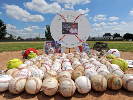 A memorial in honor of Zach Farmer was set up on the pitching mound of the Piketon High School baseball field on Saturday during the viewing held for him at the high school.