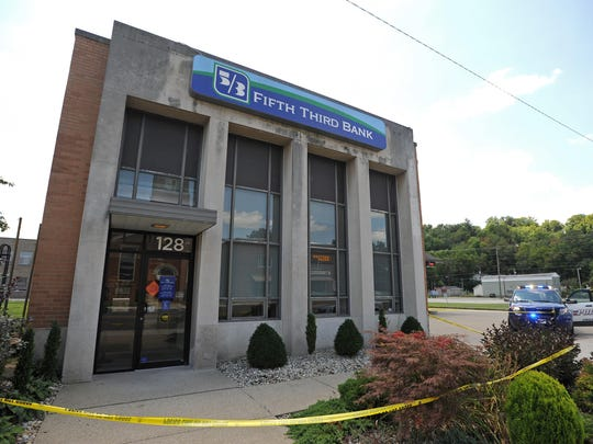 An armed suspect reportedly entered the Western Avenue 5/3 Bank on Thursday before fleeing on foot. It is currently unknown if money was stolen.