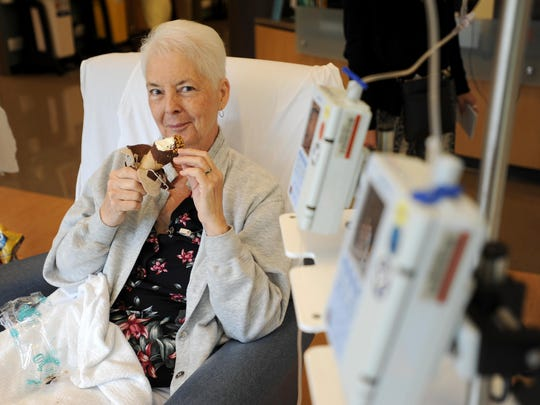 Anita Steinbrook smiles as she eats an ice cream treat from Antoinette's Ice Cream at Adena Medical Cancer Center on Wednesday during her chemo treatment. Through fundraising efforts Anthony Allen and his daughter, Antoinette Allen, 12, provided free ice cream for all patients, family members and staff at the center that afternoon.