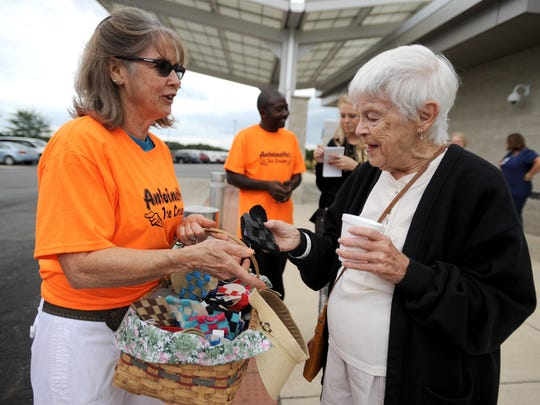 Evelyn Orr celebrated her 90th birthday at the Adena Medical Cancer Center on Wednesday with free ice cream provided by Antoinette's Ice Cream and by picking out a homemade heart made by volunteer Judy Hill Gehring, left.
