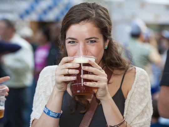 Mary Kate Gladstone of Xavier University tries the Oktoberfest beer from the Great Lakes Brewing Co. last year.