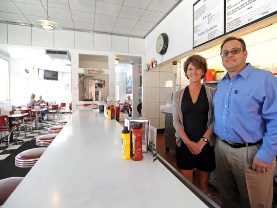 Mark and Tracy Trainer stand behind the counter for