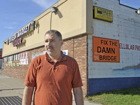 """Ronie Salem, owner of the Riviera Market, says the closed Jefferson bridge is hurting his business. """"We used to sell about 20 pizzas day,"""" he said. """"Now, we sell five. It's not worth it anymore."""""""