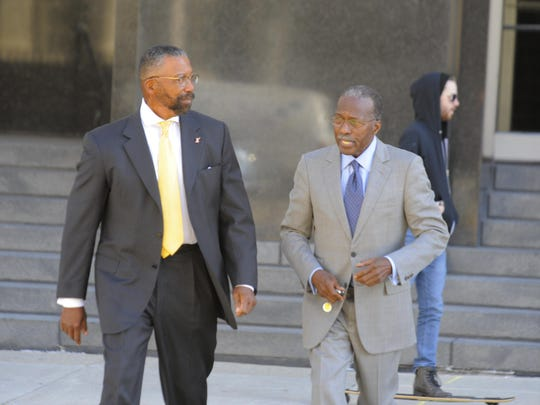 Former Detroit Public Schools emergency managers Robert Bobb, left, and Roy Roberts walk out of the Theodore Levin federal courthouse on Wednesday.
