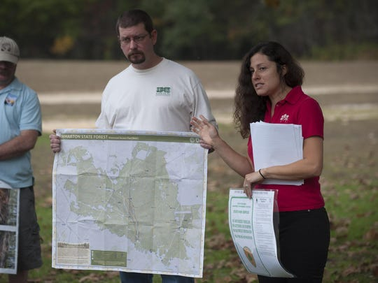 Dr. Jaclyn Rhoads, Assistant Executive Director with the Pinelands Preservation Alliance, and Chris Jage, Trustee with Rancocas Conservatory, refer to a map created by the N.J.D.E.P. in August designating 225 miles for motorized access and placed sensitive areas and forest fire service cut roads off limits to vehiclular traffic. The group says damaging off-road vehicle use has become a major problem in the Pinelands National Reserve, especially in Wharton State Forest. Tuesday, October 13, 2015.