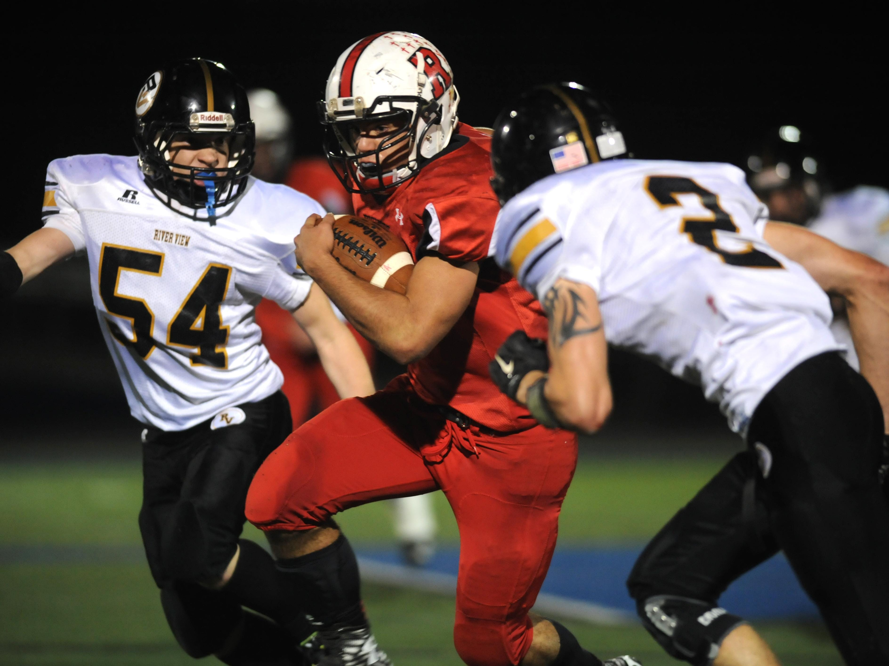 Rosecrans' Travis Johnston splits a pair of River View defenders Friday night at Zanesville High School. The Bishops beat the Black Bears 28-0.