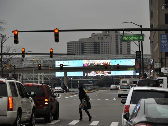 From Woodward Avenue, the digital marquee over Cobo Center's main entrance is two blocks away and the view is partially obstructed by the elevated People Mover track. Still, putting ads there could mean Michigan would lose as much as $100 million in federal funds.