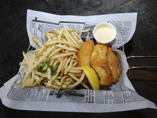 Walleye fish & chips are on the menu at the eatery, which features liquor, beer and wine that are all locally produced.