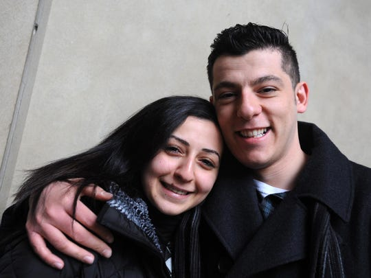 New United States citizen Noora Tela, 22, of Commerce Township stands with her husband Shidrak, outside the Federal Courthouse in Detroit after a naturalization ceremony on Monday, December 21, 2015. Shidrak is also originally from Iraq, but has been a U.S. Citizen for a while.