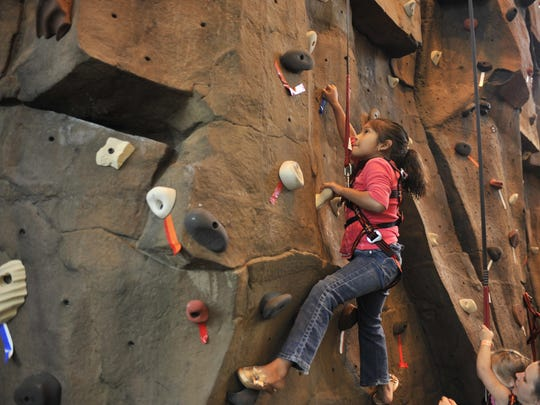 Natalie Avila climbs the rock wall at the Kroc Center.