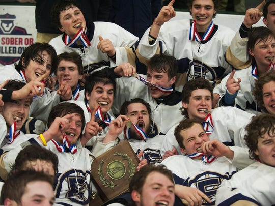 Essex celebrates its crown following the Division I high school boys hockey title game against South Burlington. The final lasted three exhilarating overtimes.
