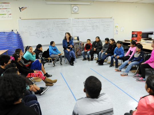 """Elizabeth Jannasch, tells the story of """"The Lute Player"""" to the students in Karen Babione's fourth-grade class Tuesday at Loma Vista School in Salinas."""