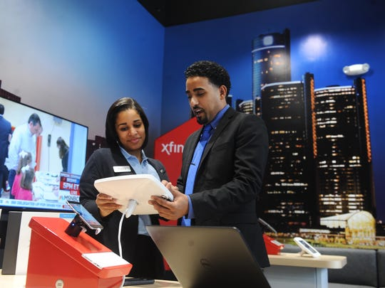 Kayla Shepard and Youness Mawry work at the newly opened Xfinity store in Detroit. Comcast is set to boost its Internet speed offerings.