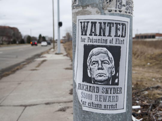 Wanted signs posted along Vernor St. at Chene on Detroit's east side call for the citizens arrest of Michigan Gov. Rick Snyder for the 'poisoning of Flint.' Photos taken on February 29, 2016. (John T. Greilick, The Detroit News)