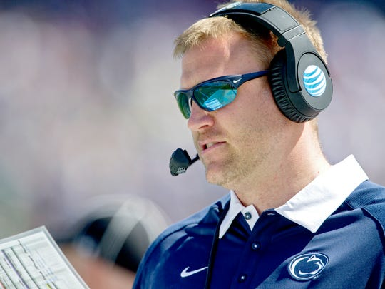 Recently promoted offensive coordinator Ricky Rahne checks some plays during the Blue-White Game in 2016. He got emotional when talking about landing the job he had been working toward for years under James Franklin.  (Abby Drey/Centre Daily Times via AP) MANDATORY CREDIT; MAGS OUT
