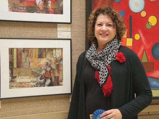 """Eileen Mollen, assistant professor emerita of pediatrics and communicable diseases, shows stands next to her art work, """"Butterfly Music"""" which won honors for collage and mixed media at the annual employee art exhibition last year at U-M Health System."""