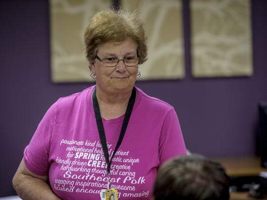 Denise Gulling enjoyed talking with her friends and colleagues who hosted a party to honor her 40 years of teaching. She will continue to teach renewing her contract.