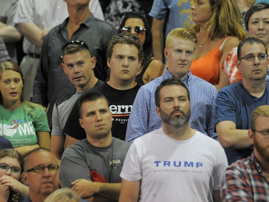 Toledo-area residents listen as Republican presidential candidate Donald Trump speaks at a rally Wednesday night. He discussed trade issues, among other campaign issues.