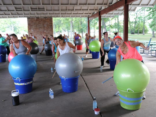 Cardio-drumming enthusiasts, Kim Anger, Lisa Hiller and Kathy Morris enjoy the workout on a beautiful summer evening at Garden City Park recently.