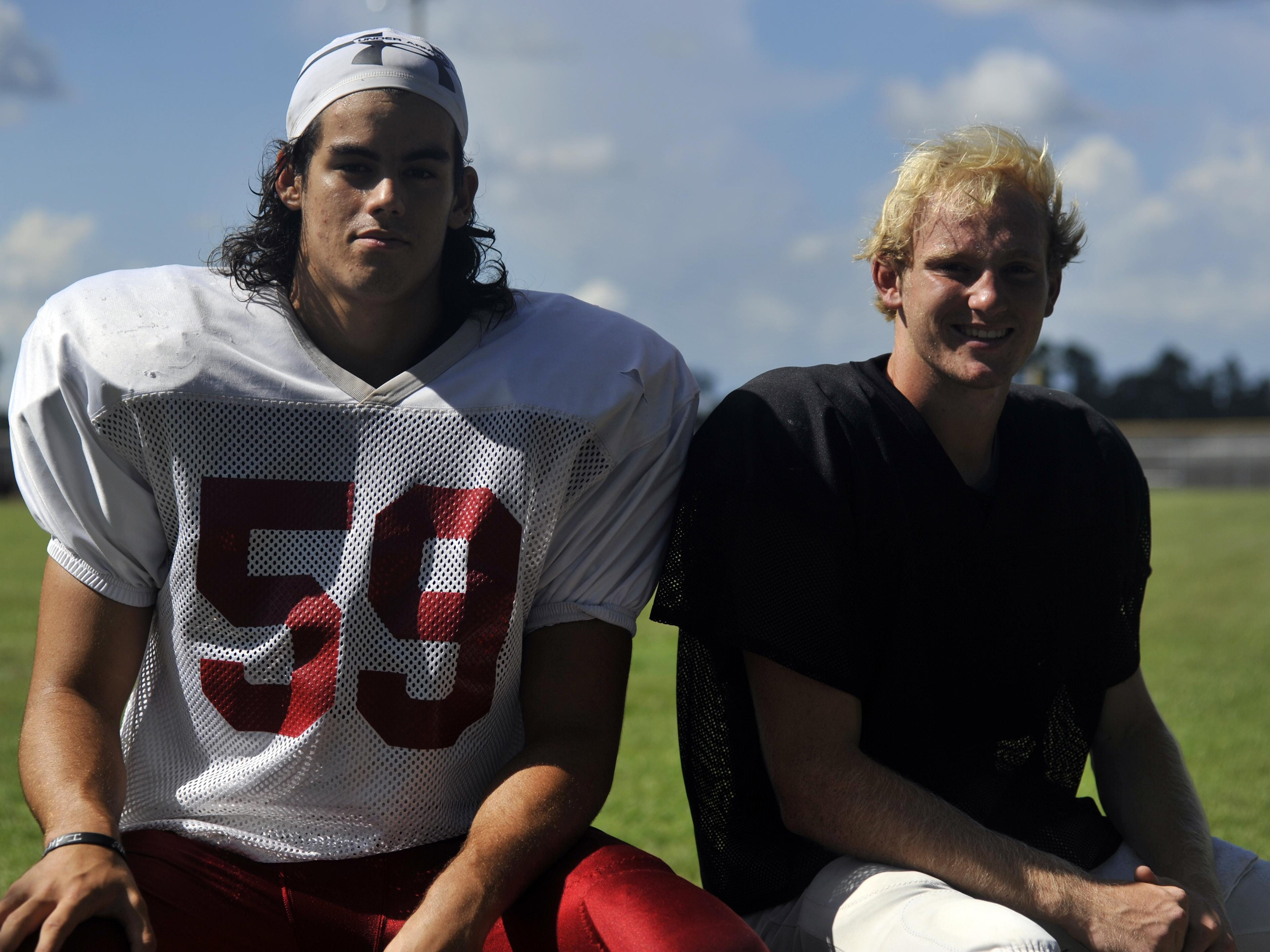 Offensive lineman Jared Bethea (left) and quarterback Jake Henry are two of the more experienced players on Tate's roster this season.
