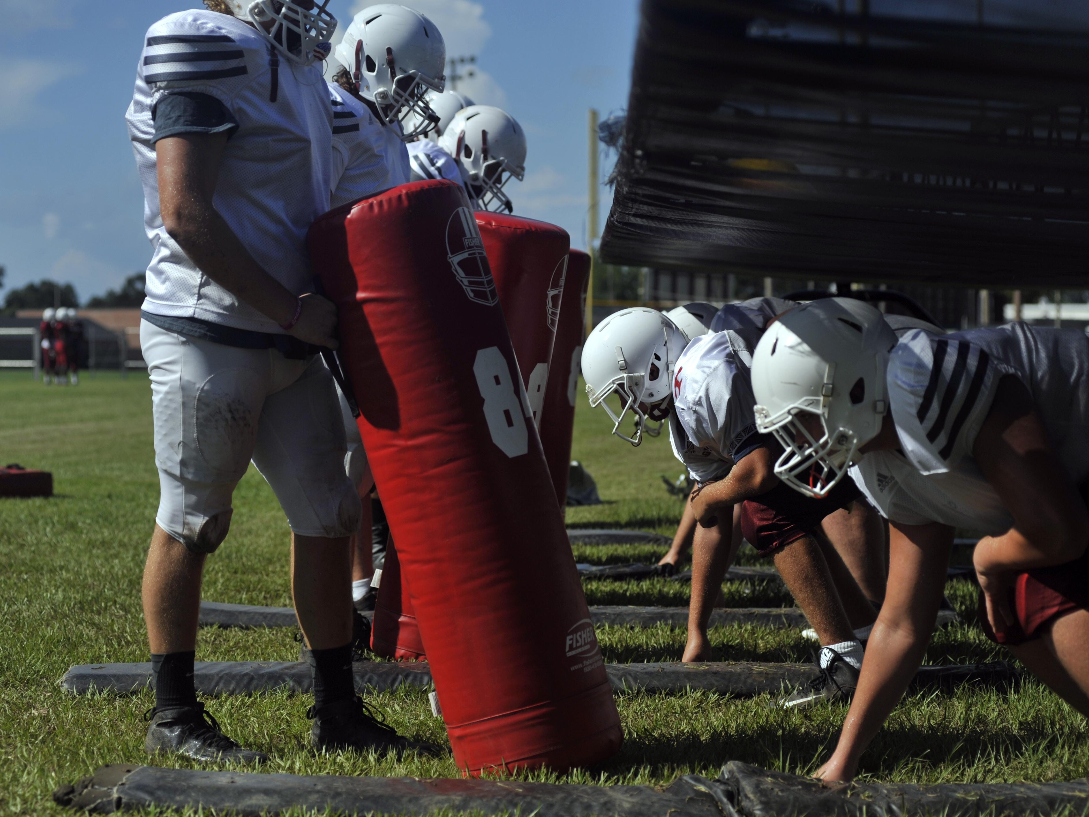 The Tate Aggies line up to run drills during practice on Aug. 16, 2016.
