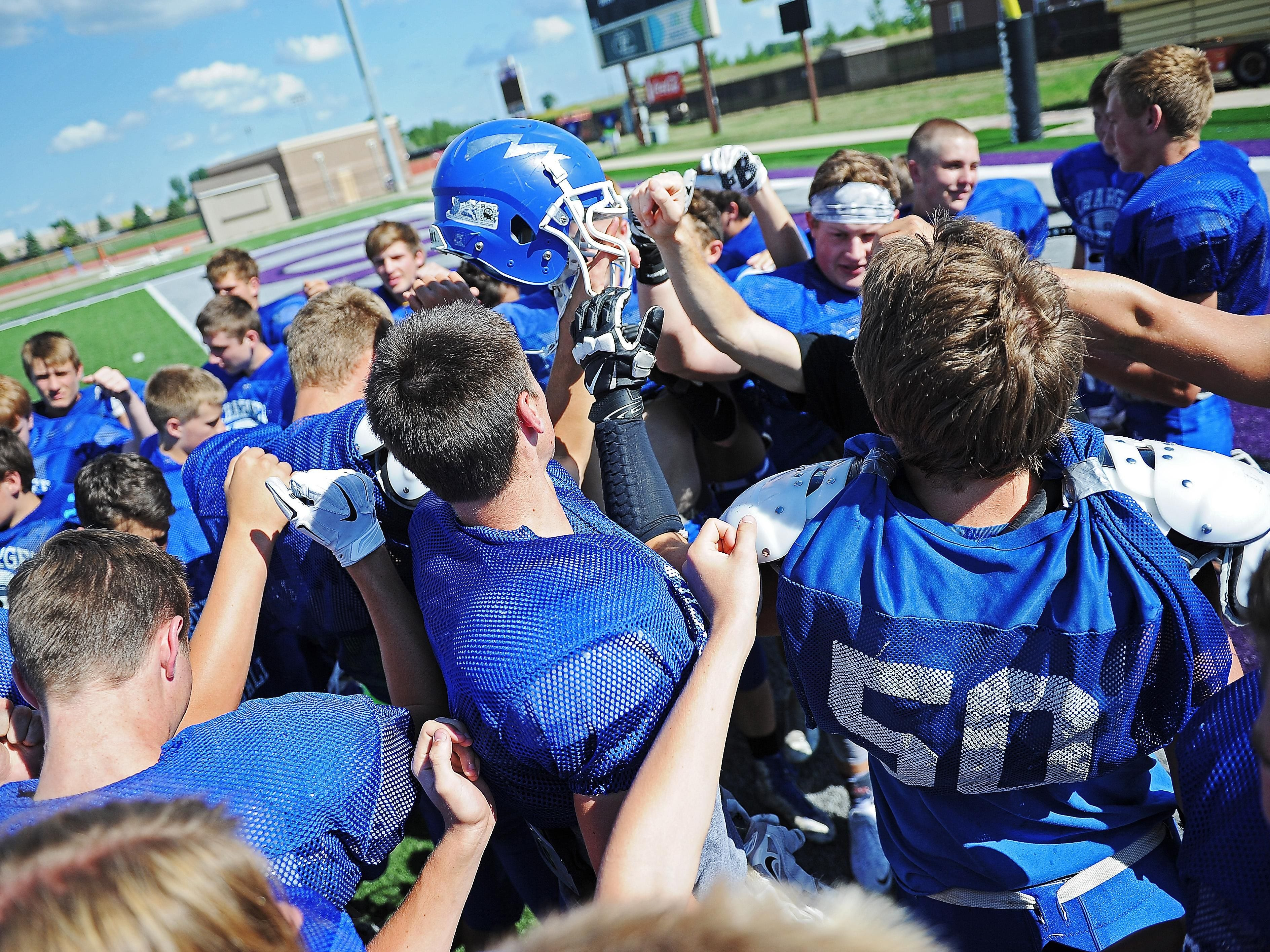 Sioux Fall Christian football players huddle during a practice Tuesday, Aug. 16, 2016, at University of Sioux Falls' Bob Young Field in Sioux Falls.