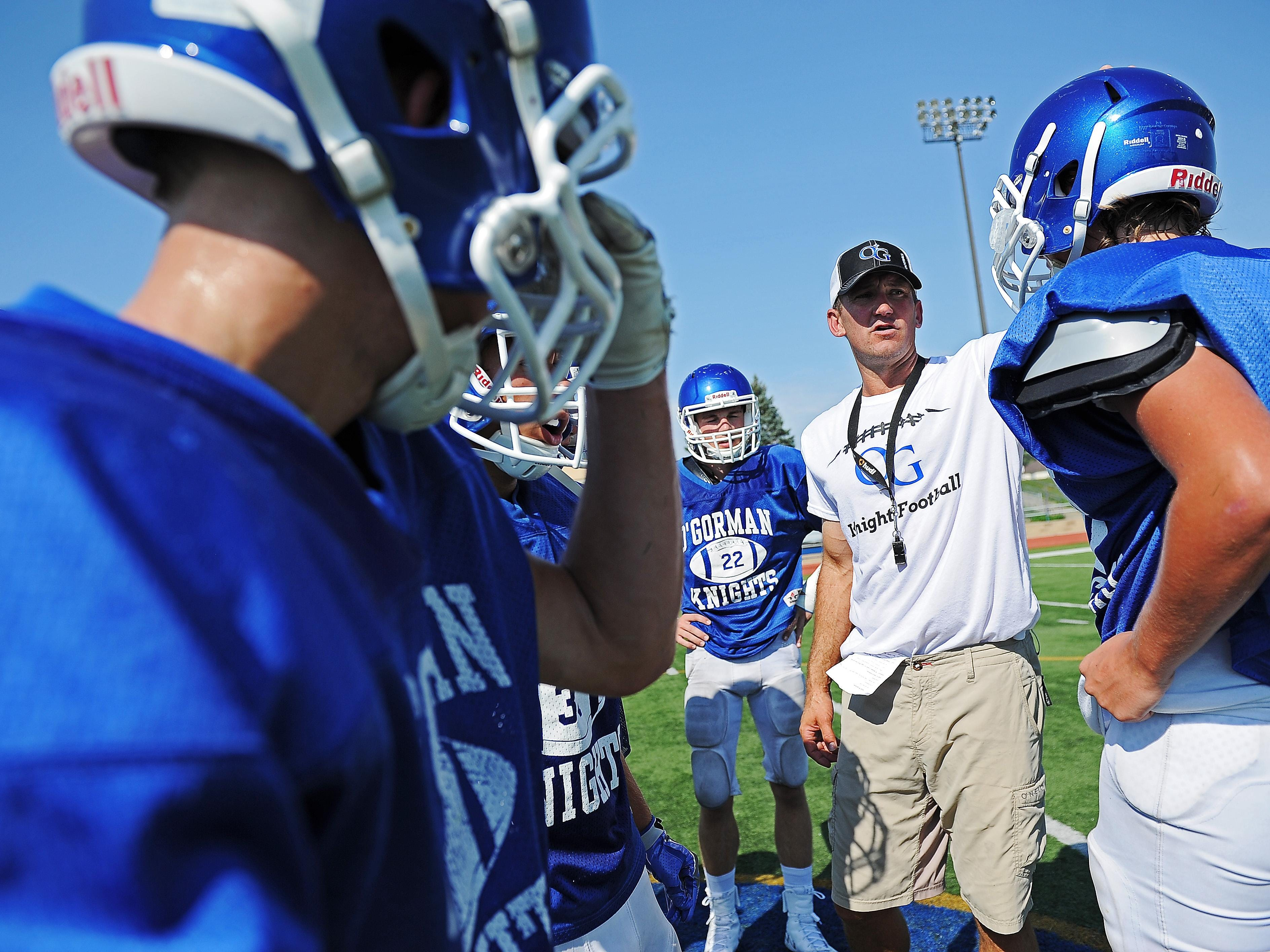 O'Gorman head football coach Jayson Poppinga talks to some of his team during practice Thursday, Aug. 18, 2016, at McEneaney Field on the O'Gorman High School campus in Sioux Falls.