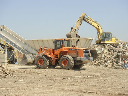 In this archive photo, materials are separated and recycled in the Construction Demolition Materials area at Pena's Disposal Service, 12094 Ave 408, Cutler.