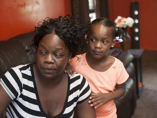 Teontae Shelby, with daughter Teona Hale, had struggled to pay off the $7,150 owed on her house. She was among owners unaware they may qualify for help based on the size of debt compared to the home's value.