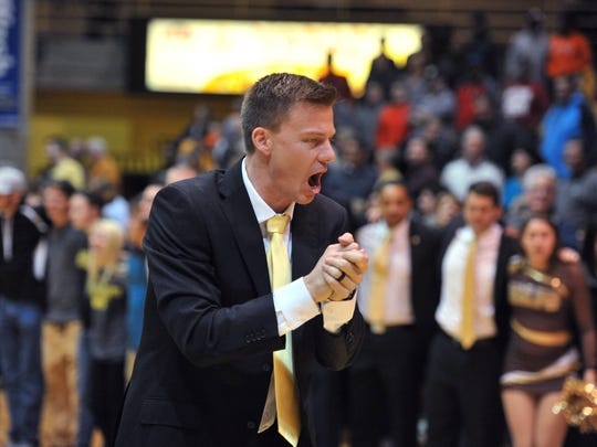 Valparaiso coach Matt Lottich applauds the team's victory over Rhode Island in an NCAA college basketball game Tuesday Nov. 29, 2016, in Valparaiso, Ind. (AP Photo/Joe Raymond)