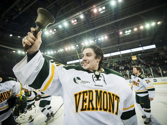 Vermont goalie Stefanos Lekkas rings the bell after the Catamounts' win over Quinnipiac in the championship game of the Friendship Four hockey tournament in Belfast, Northern Ireland.